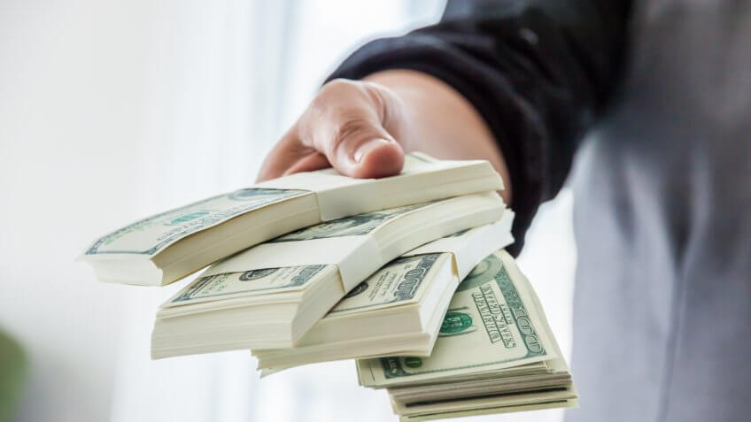 man-giving-money
