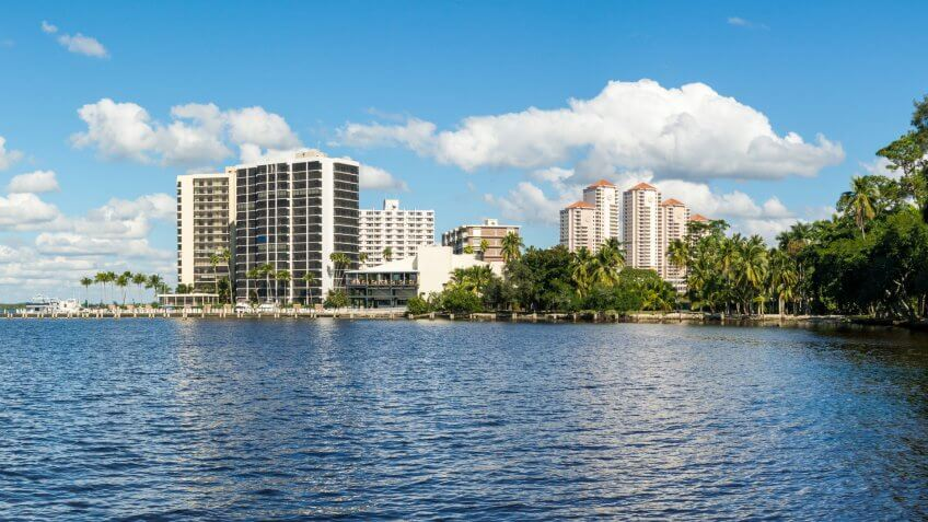 FORT MYERS, USA - DEC 11, 2015: Panorama of Caloosahatchee River with waterfront apartment buildings in Fort Myers, Florida, USA.