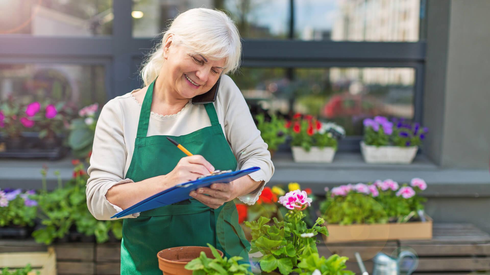 retired woman working in nursery