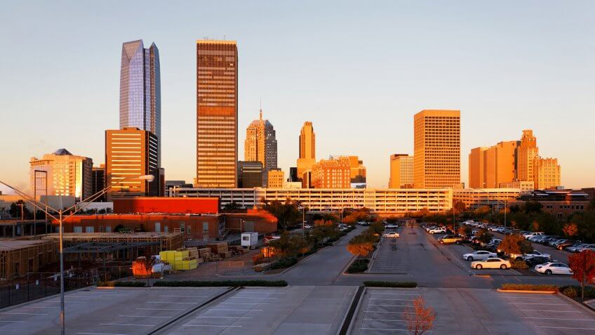 A view of the skyline of Oklahoma City at sunrise., Places to Retire