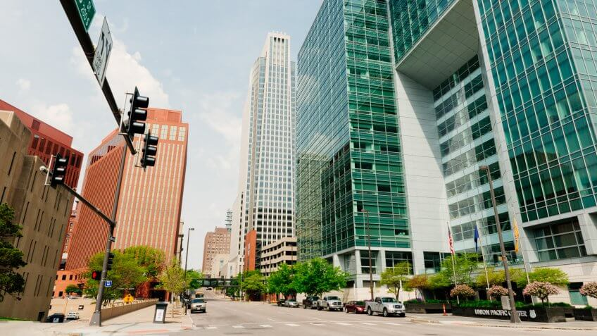Omaha, United States - May 7, 2016: Large office buildings for several businesses line the landscaped downtown streets that have little traffic on a Saturday.
