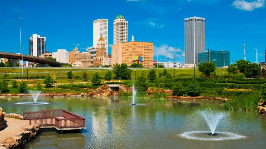 """""""Tulsa skyline with a park, pond, and fountains in the foreground."""