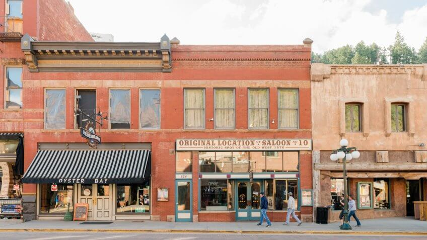 Deadwood, United States - May 8, 2016: Historic buildings in this Western South Dakota town remain active with a variety of retail businesses.