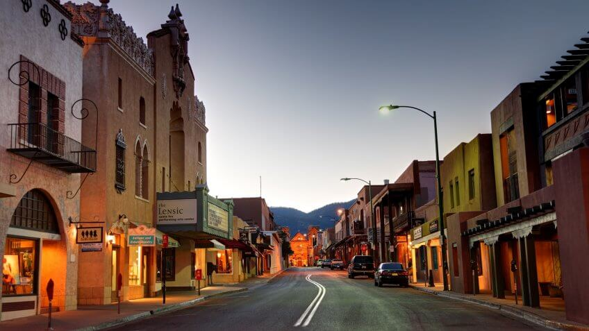 Santa Fe, New Mexico, USA - April 17, 2012: Road in the business district leading to the Cathedral Basilica of Saint Francis of Assisi at dawn.