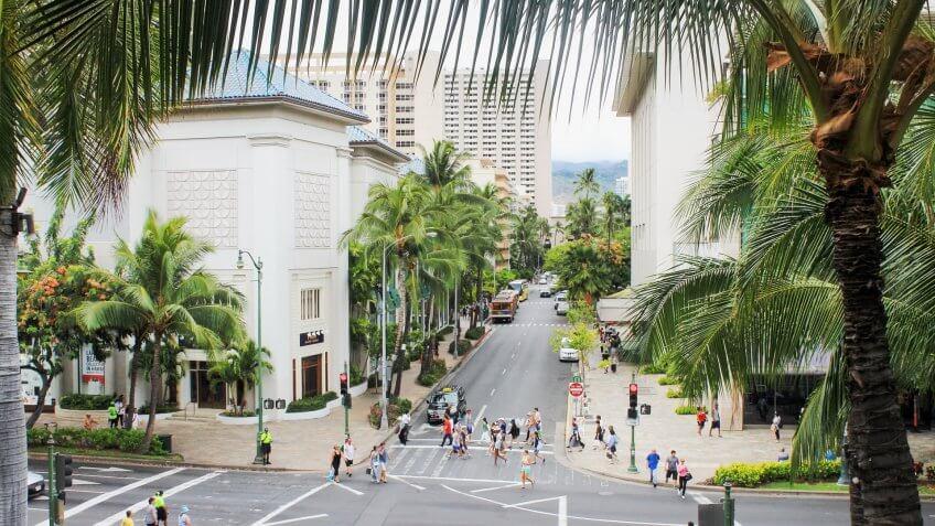 Honolulu, Hawaii, USA - May 30, 2016: Downtown Waikiki, bustling with locals and tourists.