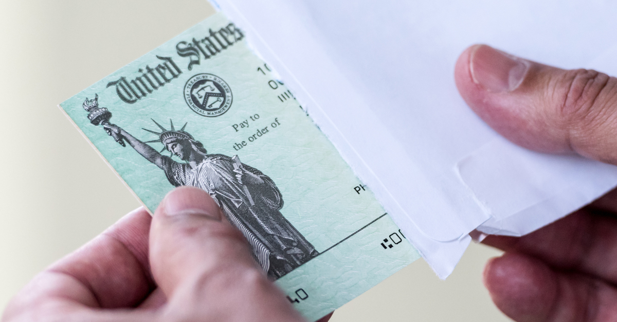 Men hands holding a US Government Treasury check.