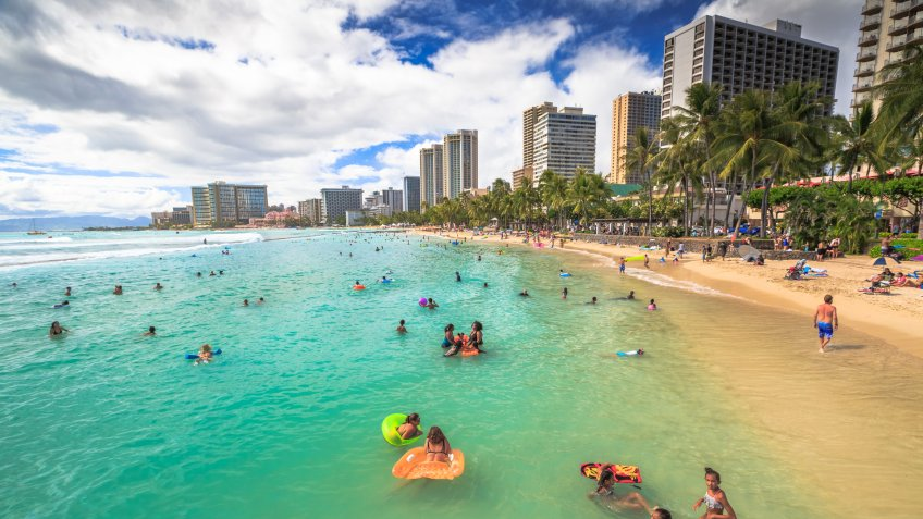 Waikiki, Oahu, Hawaii, United States - August 27, 2016: Prince Kuhio Beach also called The Ponds, because bounded by concrete walls that have created a calm water swimming pool.