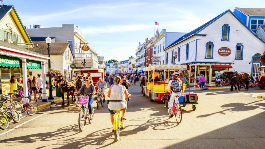 Mackinac Island, Michigan, August 8, 2016: Vacationers take on Market Street on Mackinac Island that is lined with shops and restaurants.