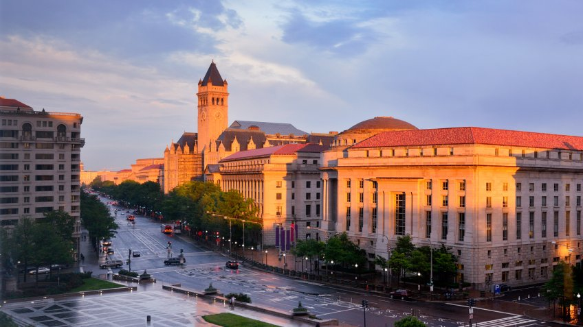 Washington's city street and post office tower at sunrise, Washington, DC, USA.
