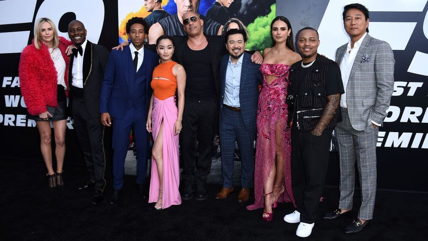 """Mandatory Credit: Photo by Jordan Strauss/Invision/AP/Shutterstock (12124760h)Charlize Theron, from left, Tyrese Gibson, Ludacris, Anna Sawai, Vin Diesel, Justin Lin, Jordana Brewster, Shad Moss, and Sung Kang arrive at the Los Angeles premiere of """"F9: Fast & Furious 9"""" at the TCL Chinese Theatre onPremiere of """"F9: Fast & Furious 9"""", Los Angeles, United States - 18 Jun 2021."""