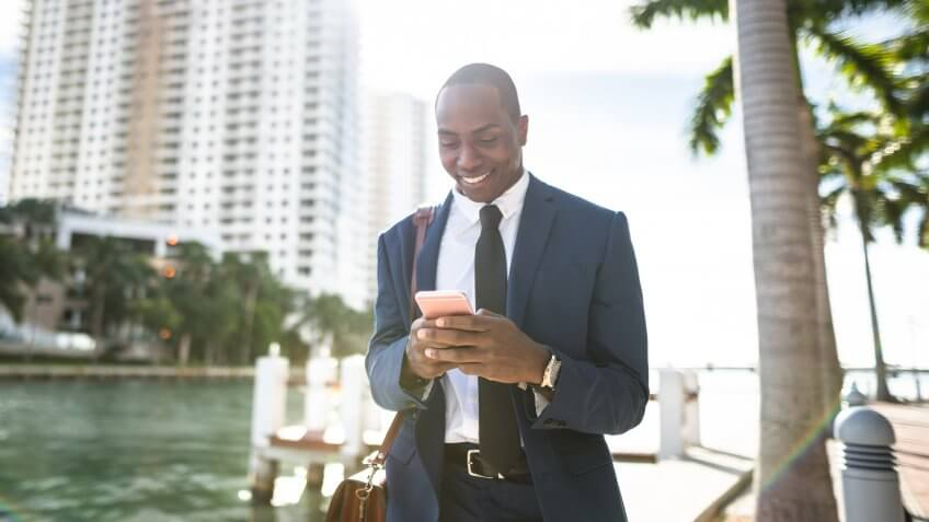 businessman texting in miami.