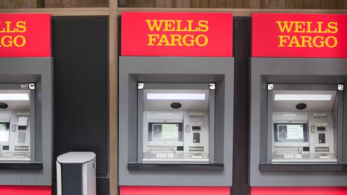 San Francisco, California, USA - April 24, 2011:  Three Wells Fargo ATM machines located side by side at a bank branch in the downtown San Francisco Financial District.
