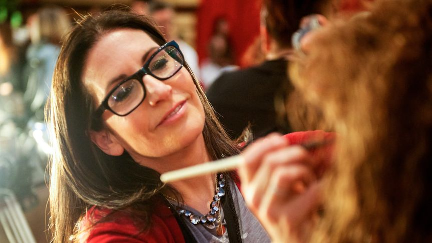 Makeup artist Bobbi Brown applying makeup on a model