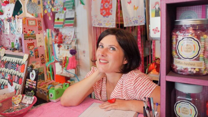 Young millennial female working in a cute stationary shop