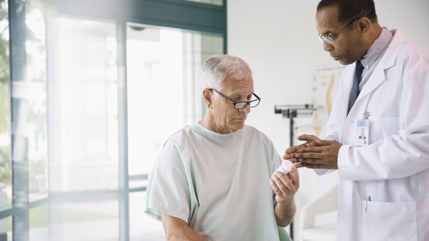 Doctor discussing prescription with senior patient.