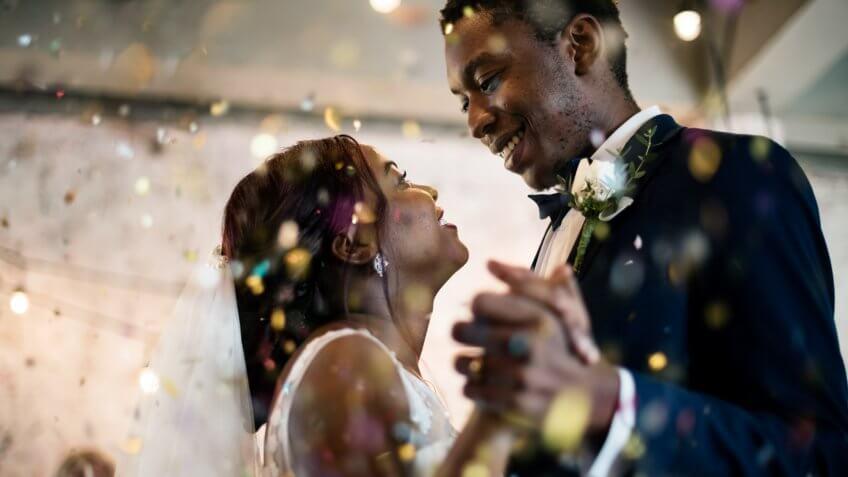 Newlywed couple dancing wedding celebration.