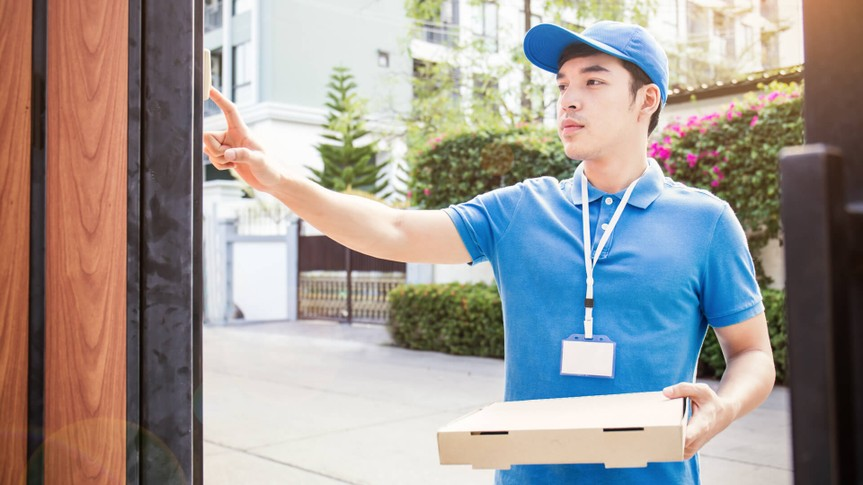 Delivery person ringing doorbell