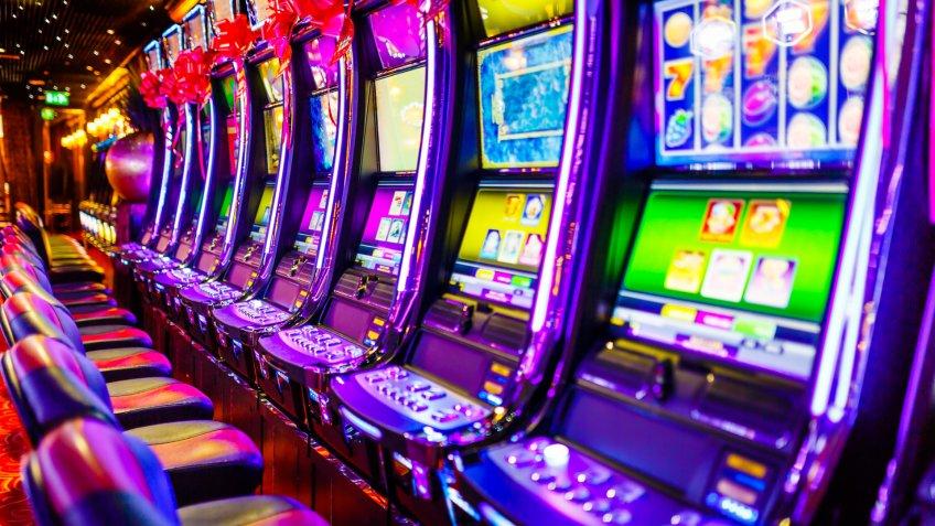 Stock, shares, NASDAQ, S&P 500, money, Line of electronic slot machines in casino.