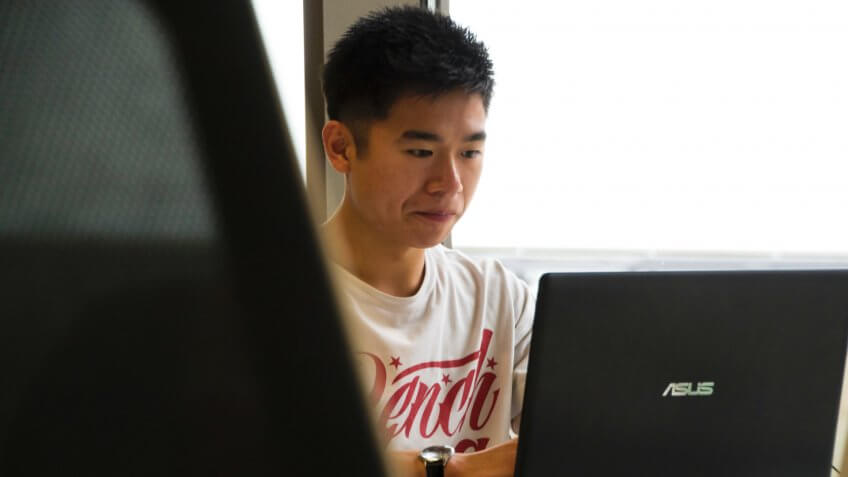 Young man working on a laptop