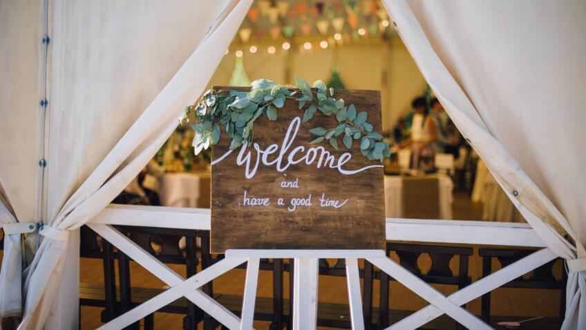 handmade wooden board with welcome sign on it