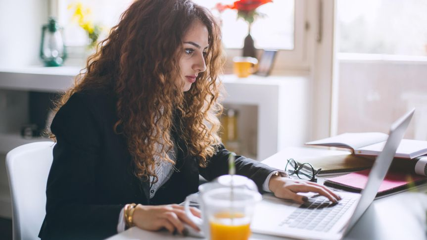 Stylish woman working in her modern office
