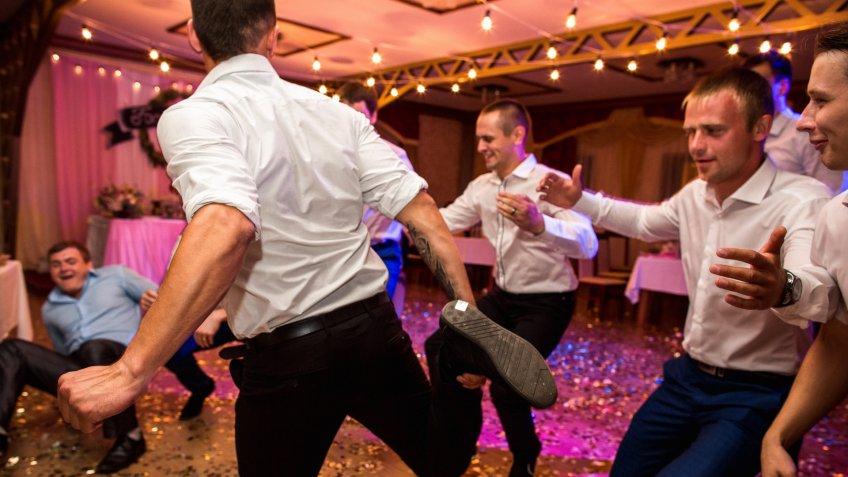 Groomsmen at wedding banquet
