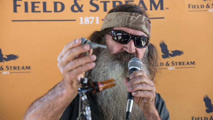 Phil Robertson, reality television star from the Duck Dynasty series, demonstrates a duck call during a recent store appearance at the new DICK'S Sporting Goods Grand Opening Celebration at the Baybrook Mall in Friendswood, TX onDICK'S Sporting Goods Houston Grand Opening Celebration, Friendswood, USA.
