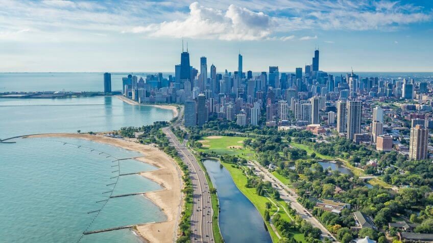 Chicago Skyline aerial view with road by the beach.