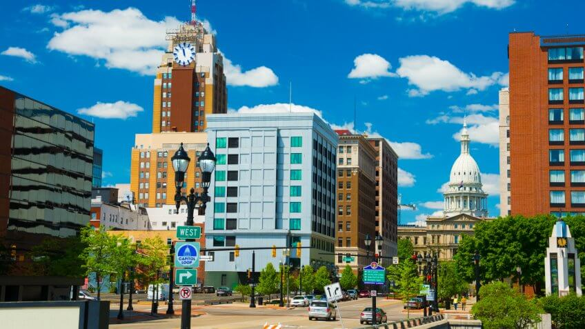 Lansing downtown skyline (with the Boji Tower on the right) with the Michigan State Capitol building in the back.