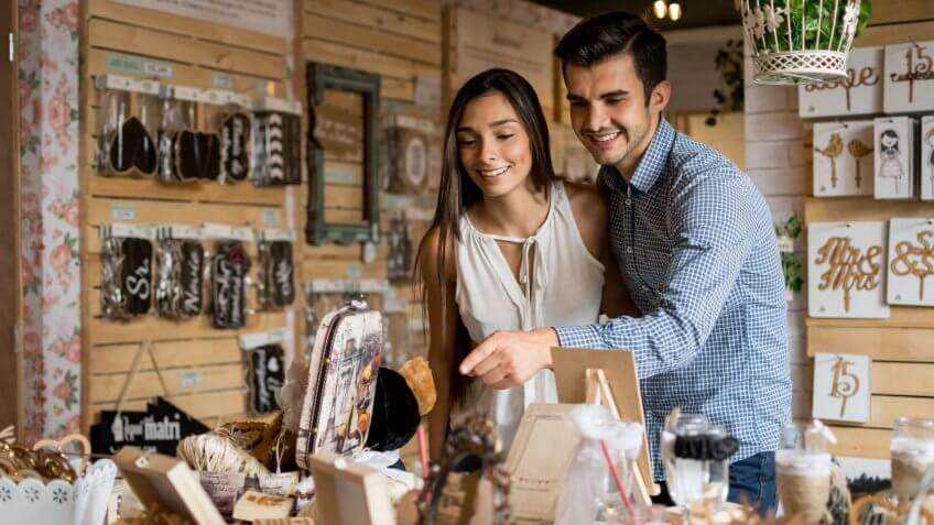 Young couple looking to buy wedding favors
