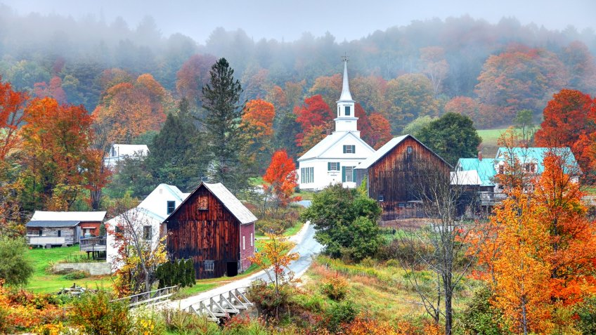 Peak autumn foliage near rural Waits River in Vermont.