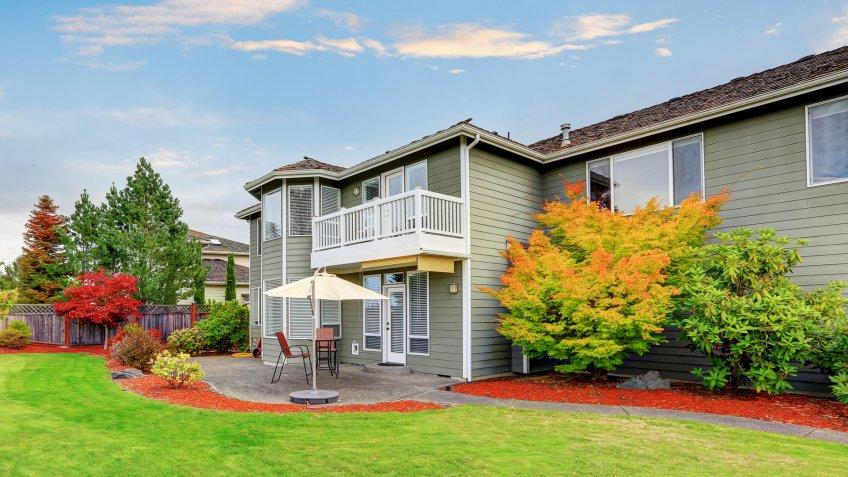 Backyard garden and patio area of American house