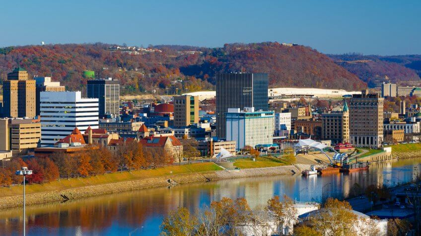 Charleston, West Virginia elevated skyline view (during Autumn), with hills and the Kanawha River included in the view.