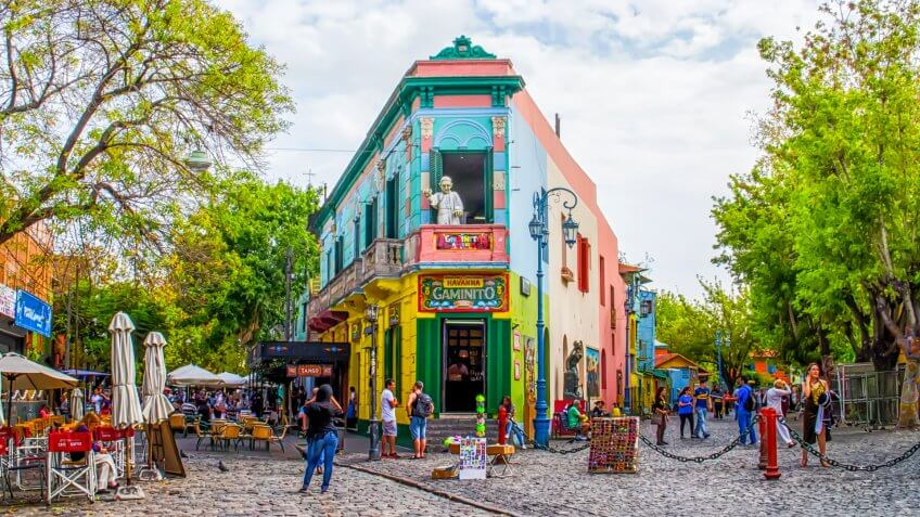 Buenos Aires, Argentina - April 15, 2015: The main square on of the Camanito in the La Boca neighborhood of Buenos Aires features brightly colored buildings and cobblestone streets that are a popular tourist destination.