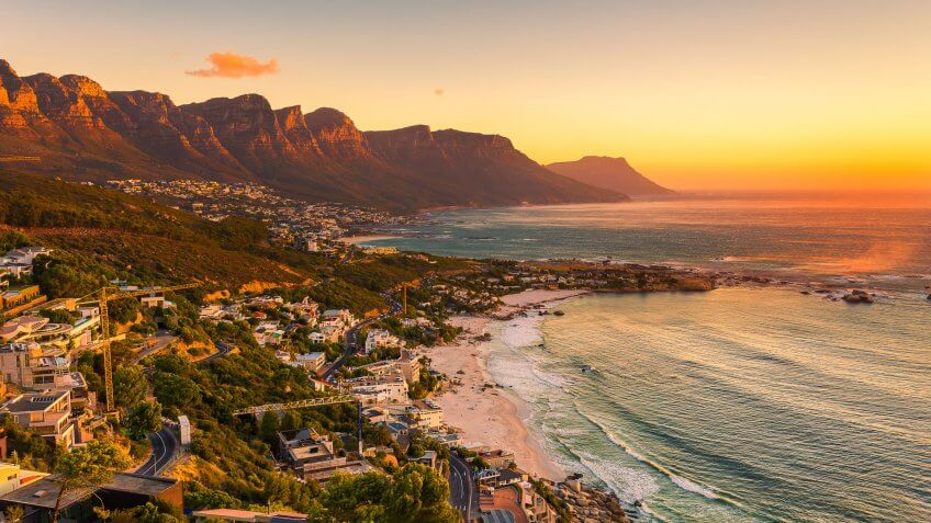 A wide picture of Clifton Beach in Cape Town, South Africa at late afternoon in a beautiful sunset.