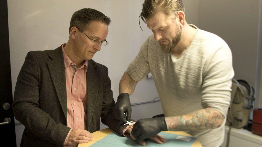 A picture made available on 04 March 2017 of David Holecek (L) getting a chip implanted in his hand by Jowan Osterlund (R) of the company Biohax, in Gothenburg, Sweden, 02 December 2015.