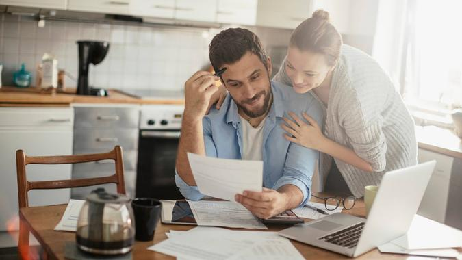 Photo of a young couple calculating home finances.