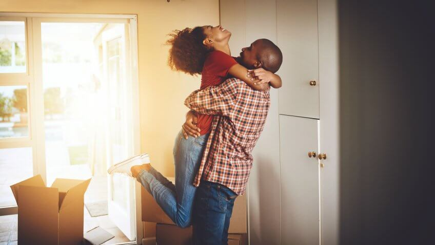 Cropped shot of a young couple celebrating their move into a new home.
