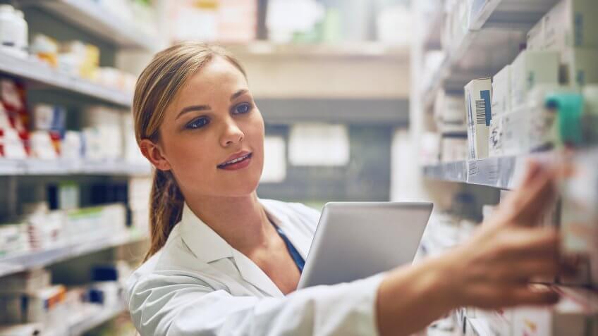 pharmacist using her digital tablet