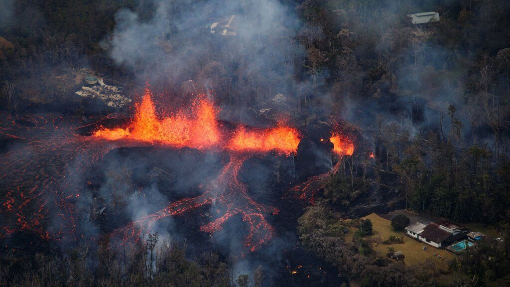 Photo by BRUCE OMORI/PARADISE HELICOPTERS/EPA-EFE/REX/Shutterstock Activity continues as a fissure eruption fountains more than 100 feet into the air near Pahoa, Hawaii, USA, 06 May 2018.