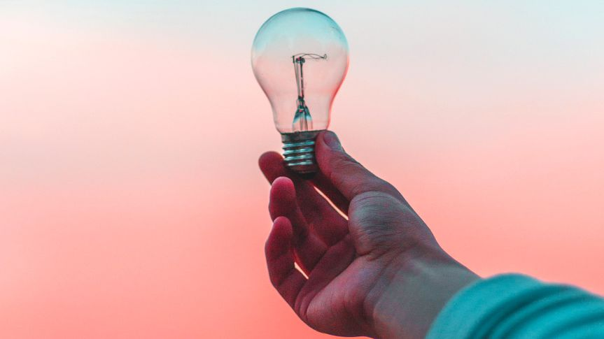 hand holding lightbulb.