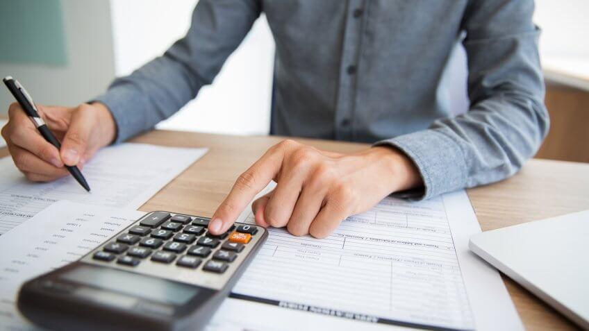 accountant examining financial report.