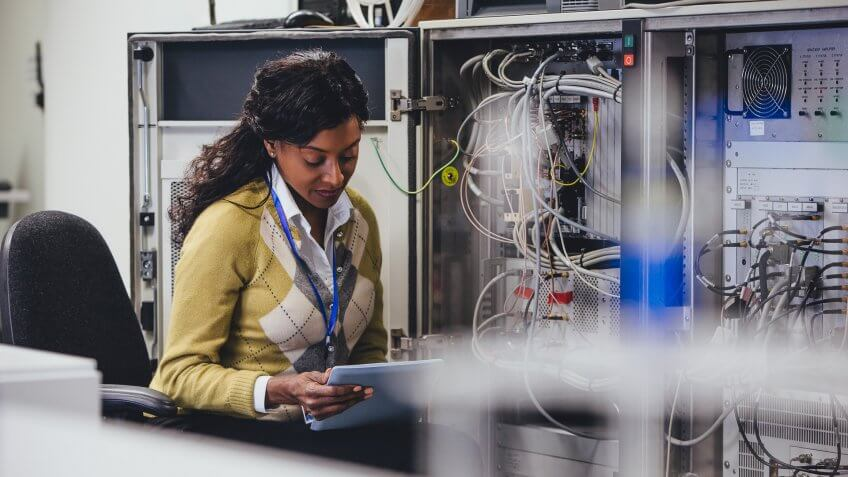 One woman checking on network servers