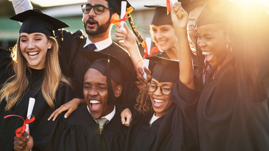 Shot of a group of cheerful university students on graduation day.