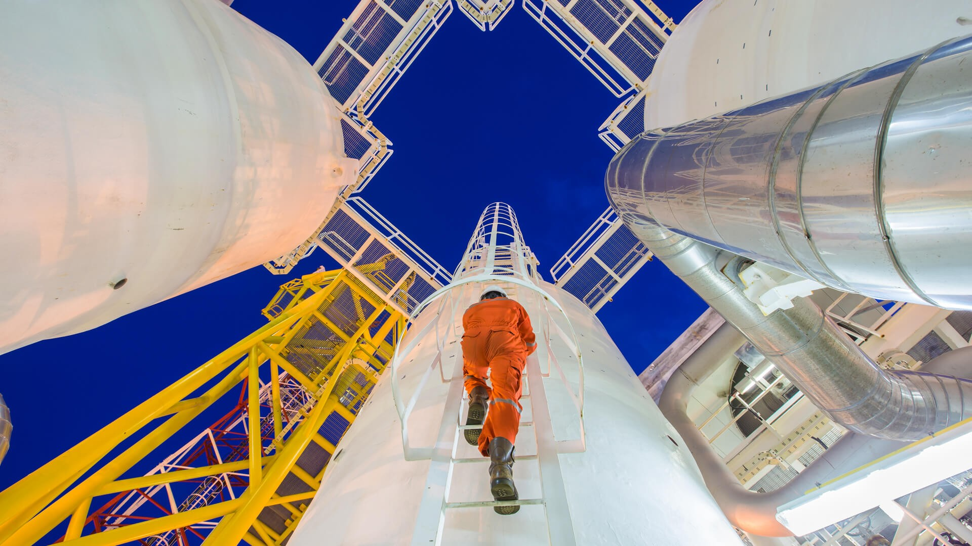 Engineering climb up to oil and gas process plant to observer gas dehydration processing in night shift.