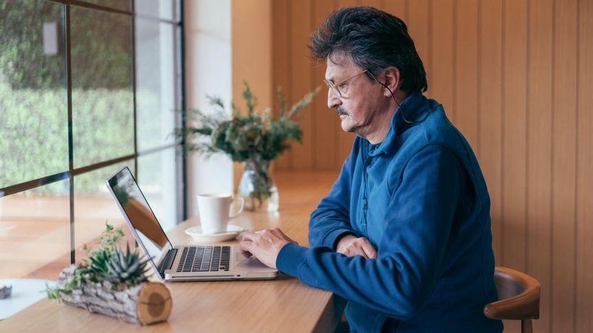 Senior man using laptop.