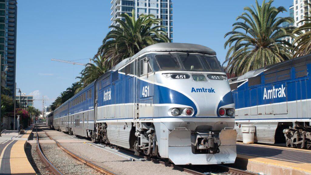 Amtrak California passenger train leaves the Santa Fe Depot station. The classic design station.