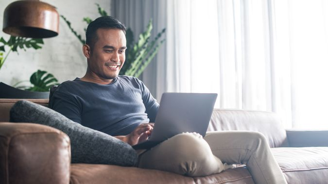 Man working on laptop in the living room