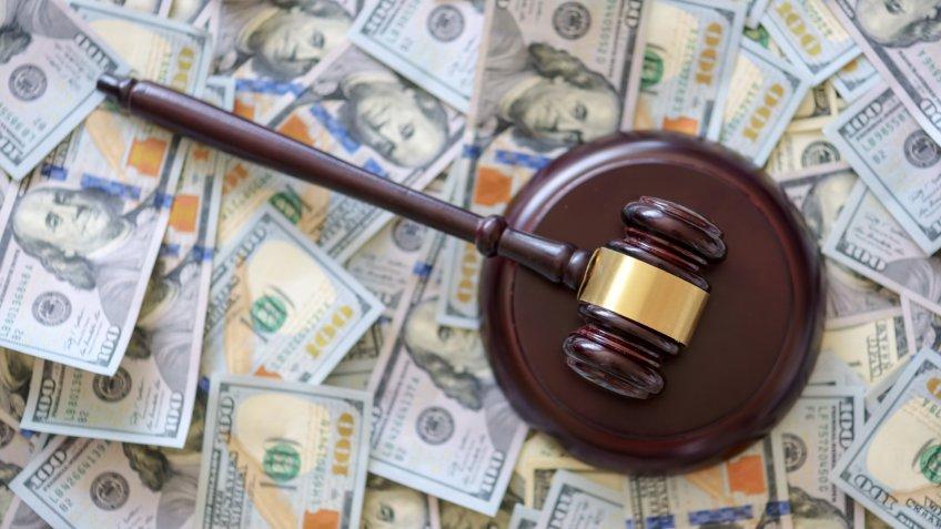 wood gavel on cash background.