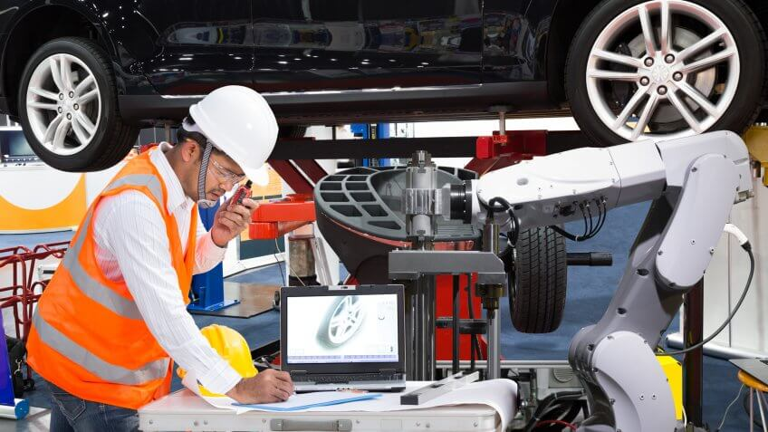 Automotive engineer with assistance robotic inspec modern car, Industry 4.
